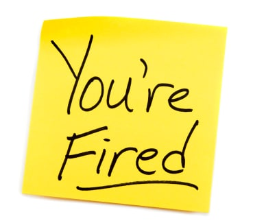 Yellow Post-it note with You're Fired message.